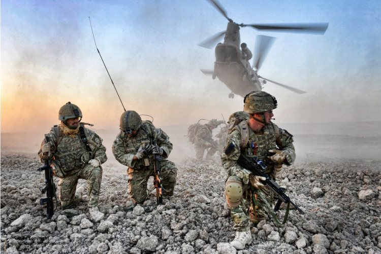 Soldiers from 7 Para Royal Horse Artillery Establish Comms by Radio Following Insertion by Chinook Helicopter in Afghanistan